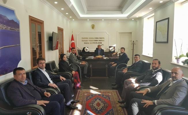 Başkan Toklu ve ekibi Kaymakam Harputlu'yu ziyaret etti