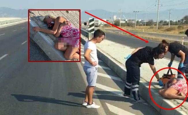 Alkolü fazla kaçıran kadın yol kenarında sızdı