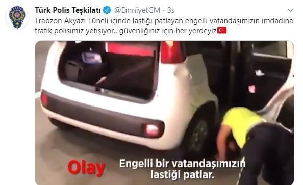 Trabzon'da trafik polisi lastiği patlayan özel gereksinimli sürücünün lastiğini değişti