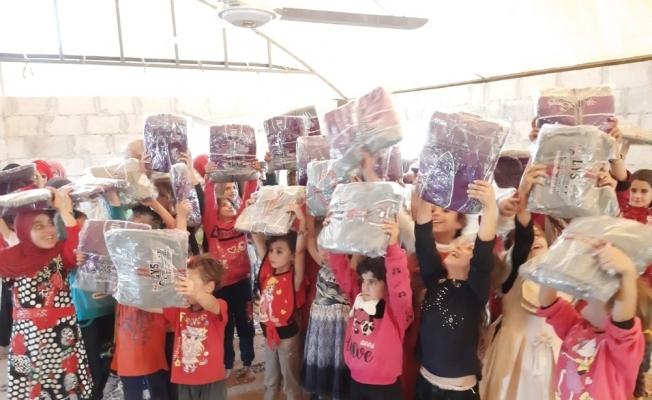 İmkander'den bin 500 çocuğa kışlık elbise yardımı