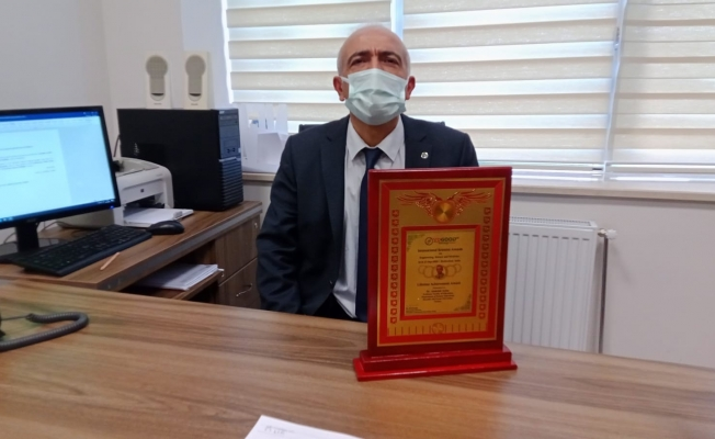 Ahi Evran Üniversitesi öğretim üyesi Aydın, 'Yaşam Boyu Başarı' sertifikası aldı