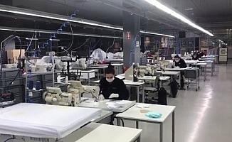 Eren Holding'den yüz binlerce maske ve tulum desteği