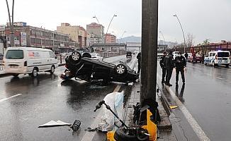 Takla atan otomobilden burnu bile kanamadan kurtuldu