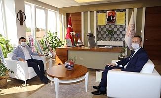 Başkan Tütüncü'den Müdür Er'e ziyaret