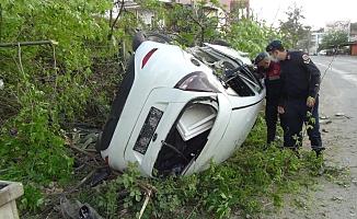 Takla atıp hurdaya dönen otomobilden hafif yaralı kurtuldular