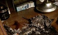 Bilgisayar üzerinde bıraktığı kitap yangın çıkardı